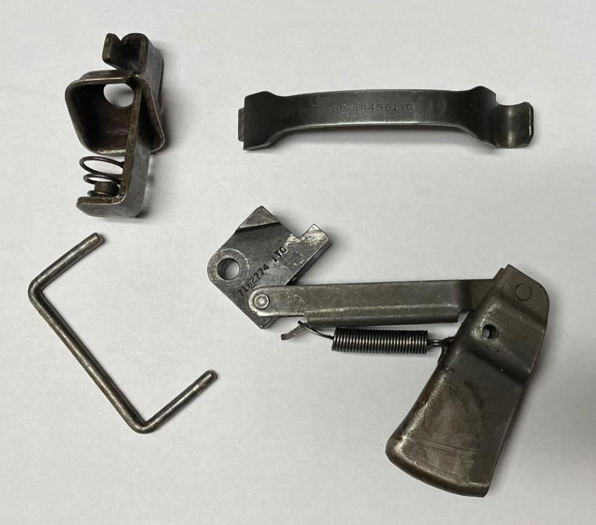 M3 trigger and mag release parts.jpg